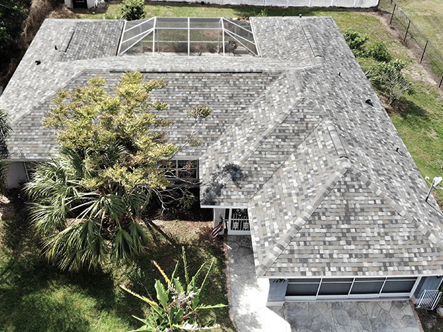 Looking down at a shingle roof on house by mark kaufman